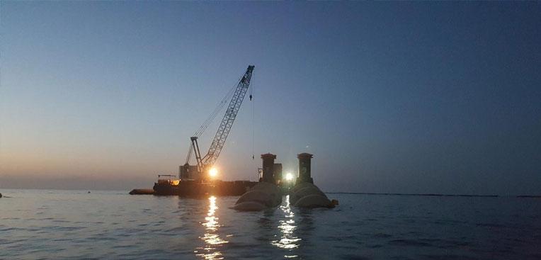 Pipeline sinking at Qurayyat desalination plant Oman .